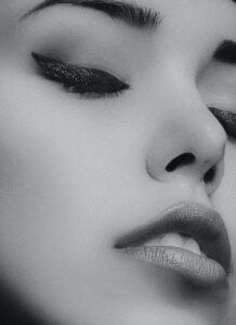 graycale photography of a woman s face