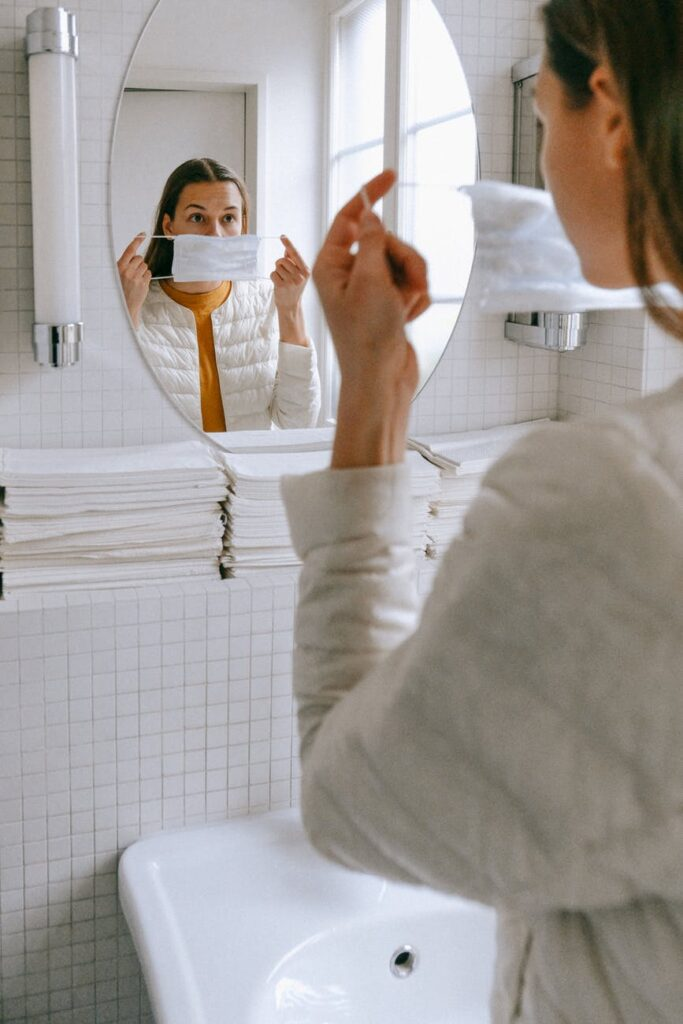 woman putting on a face mask