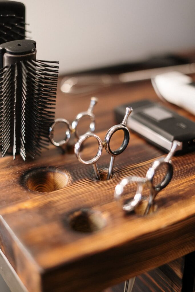 silver and black skeleton key on brown wooden table
